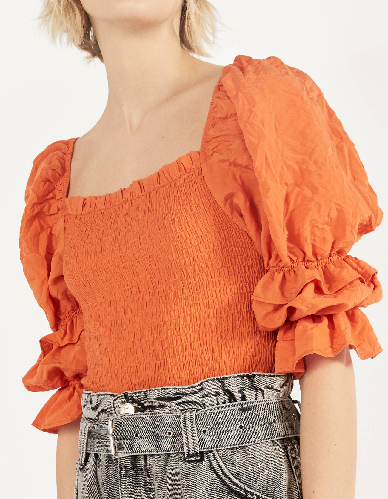 Orange blouse with volume