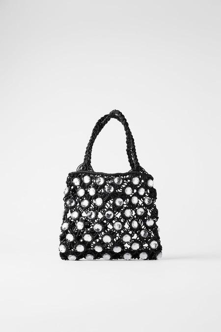 Mini bag format in black.