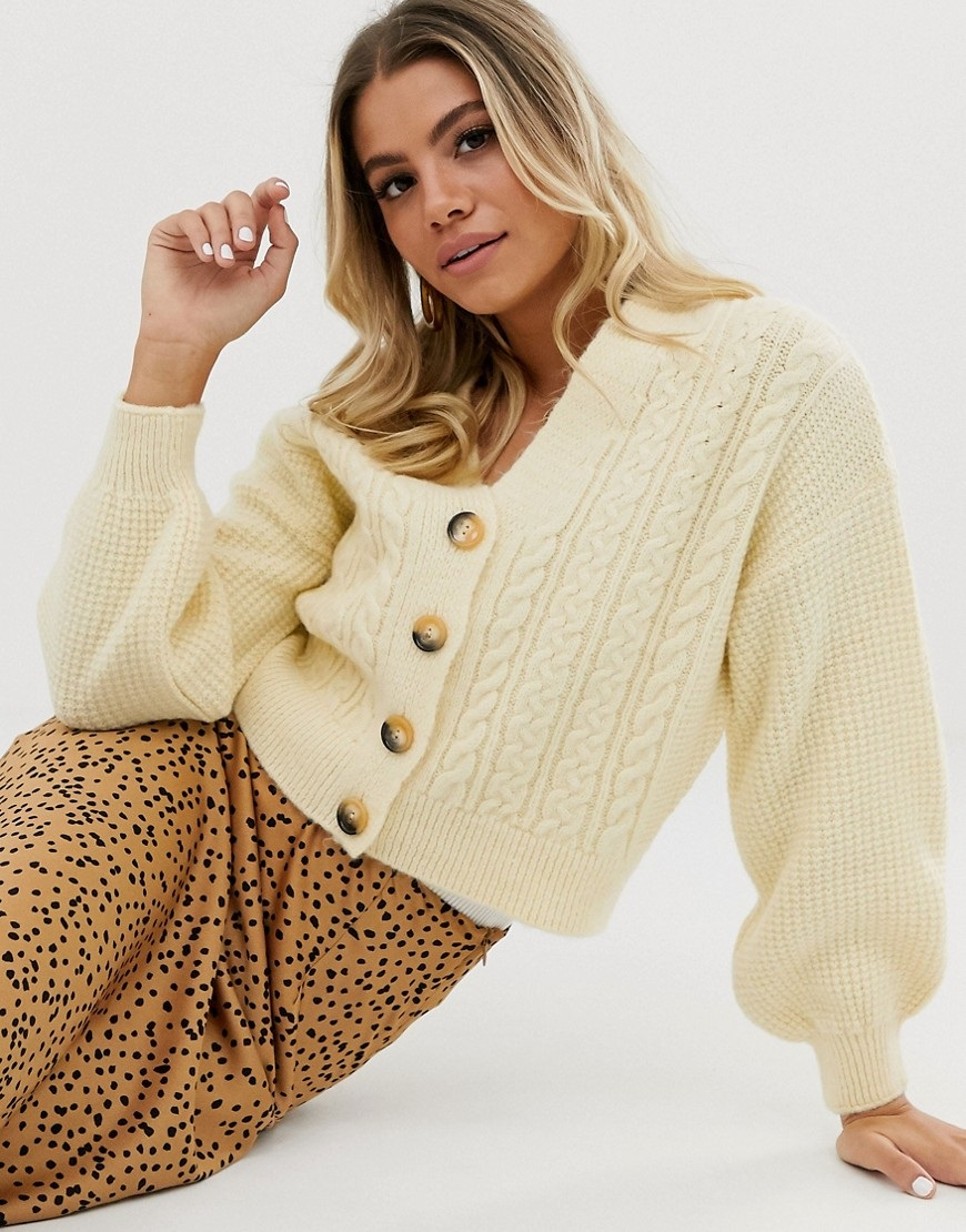 Knitted cardigan with puffed sleeves
