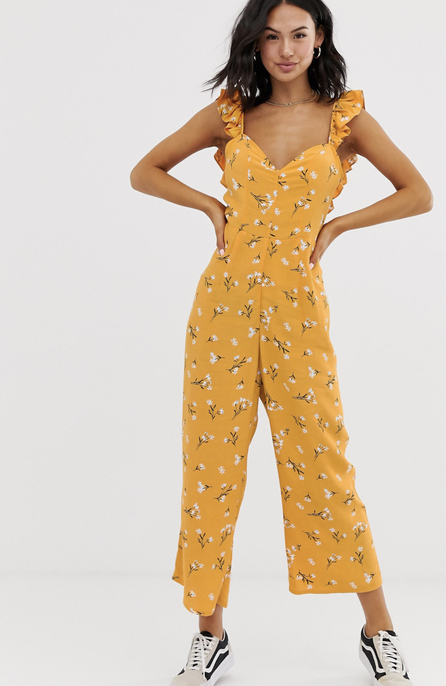 Long yellow jumpsuit with ruffles on the straps, floral print and bow on the back of ASOS DESIGN