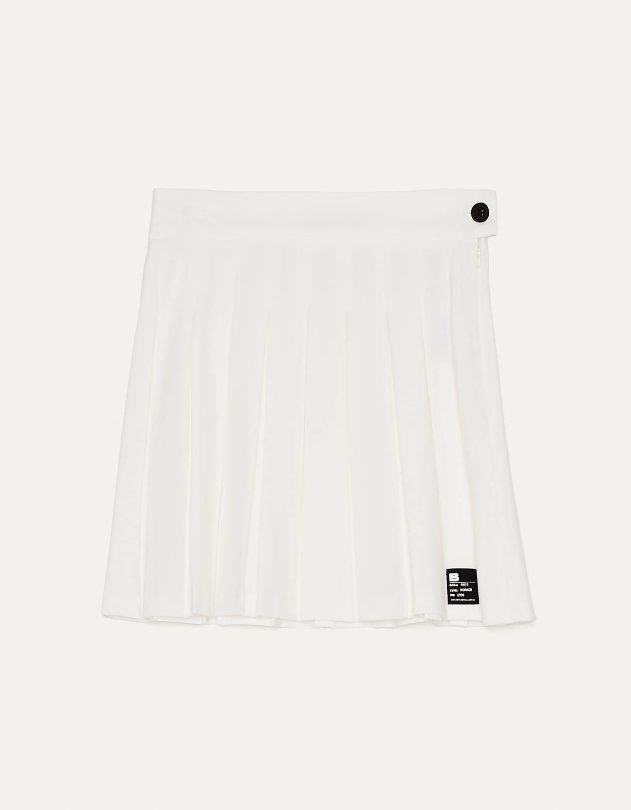 White mini pleated skirt with black details.