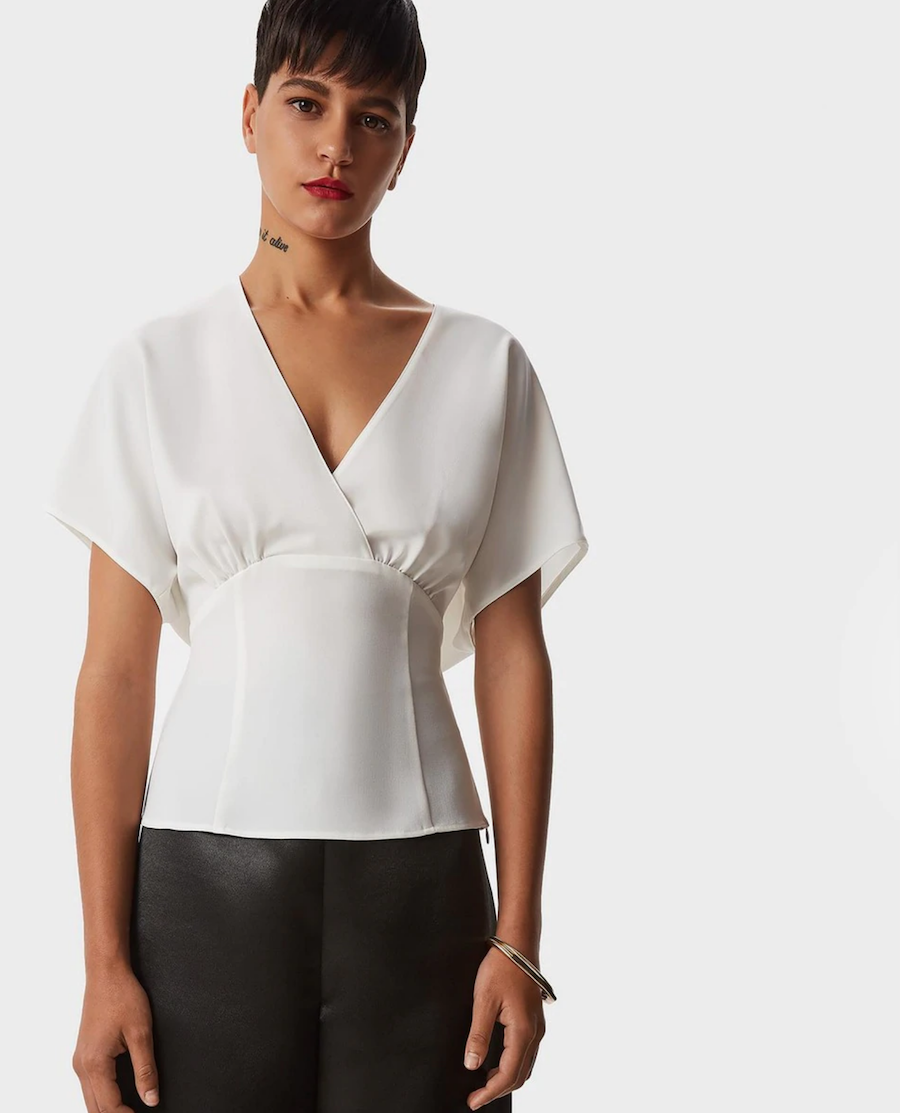 Short-sleeved plain women's blouse with a crossover neckline