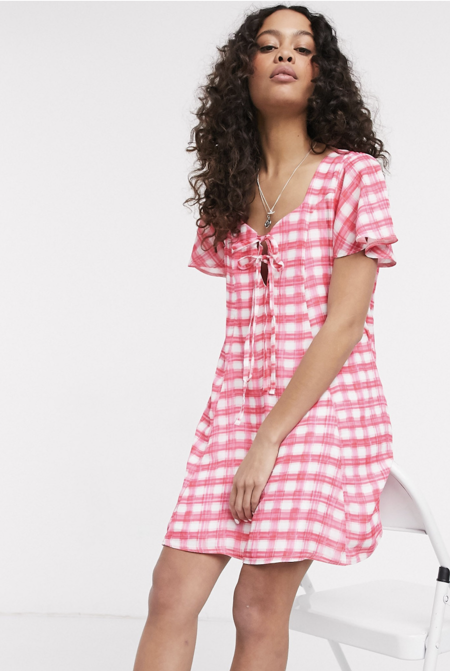 Wide dress with bow on the front and Another Reason's pink checkered design