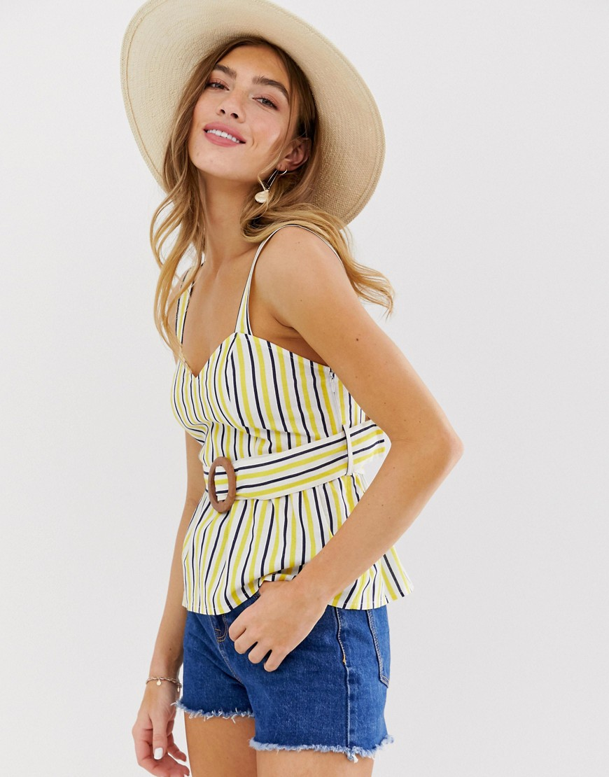 Striped summer top with overskirt and belt.