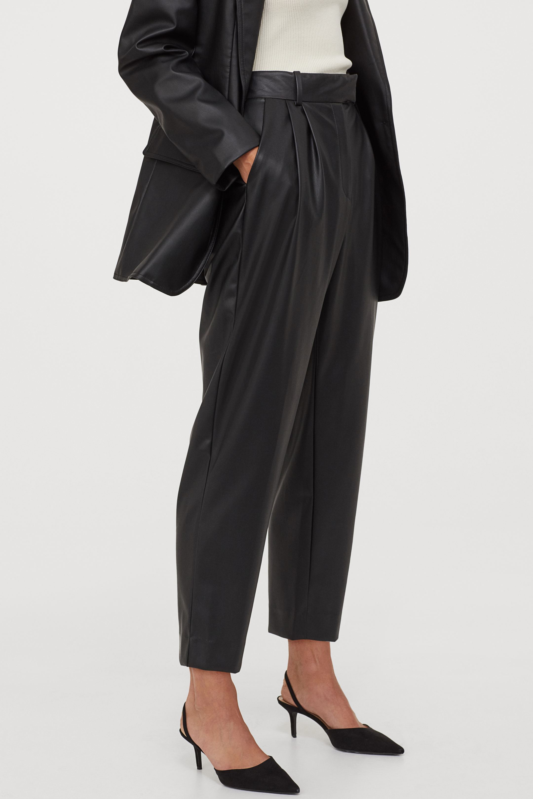 Slouchy pants with synthetic leather clips