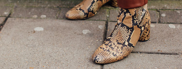 Break away from the simplicity of mid-season looks with snake print boots