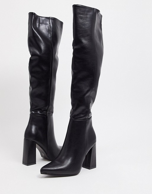 High boots with wide shank and thick heel