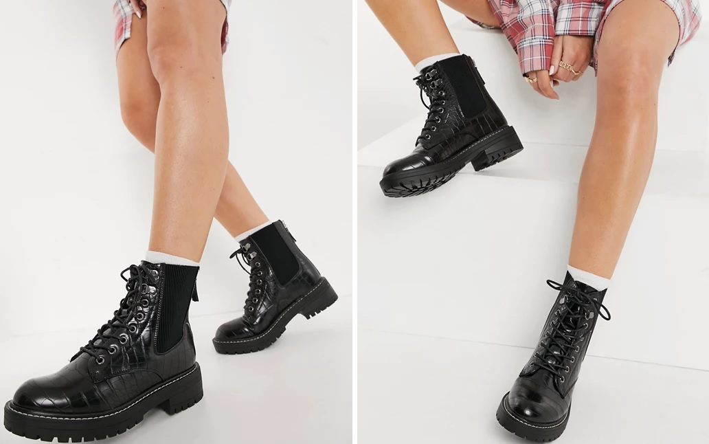 Crocodile-effect lace-up boots.