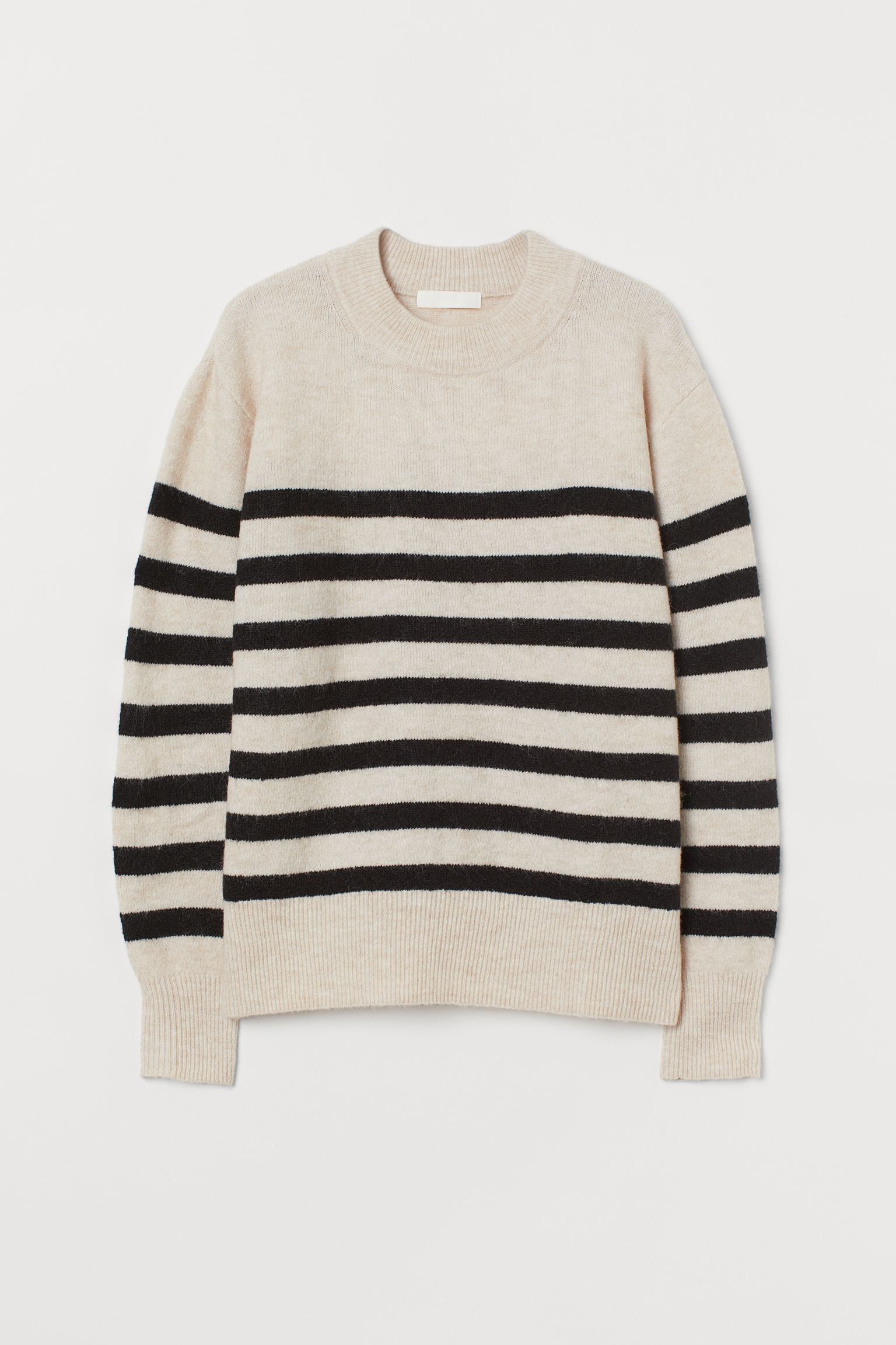 Sweater in soft fine knit with wool in the weft. Square-cut model with dropped shoulders and ribbed trim on collar, cuffs and hem. Made from recycled polyester.