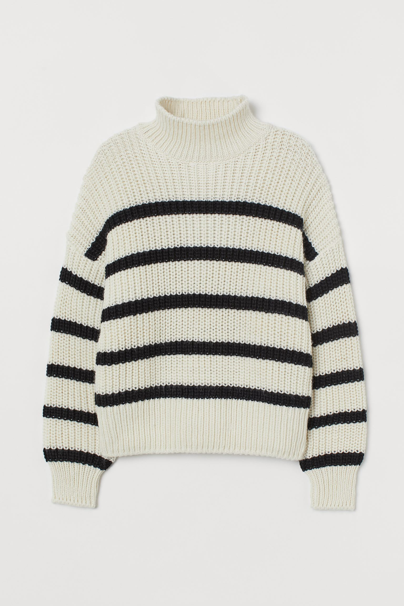 Boxy sweater in soft knit with wool in the weft. Model with ribbed perkins collar, dropped shoulders and ribbed elastic cuffs and hem. Made from recycled polyester.