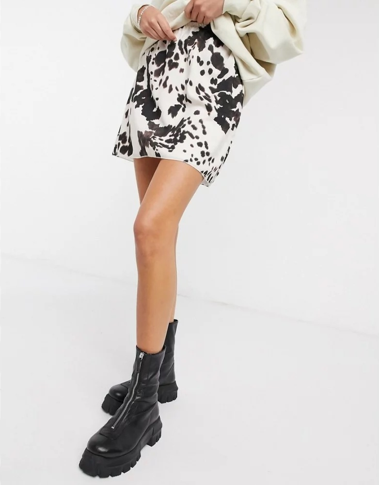 Cow print flared mini skirt by Another Reason.