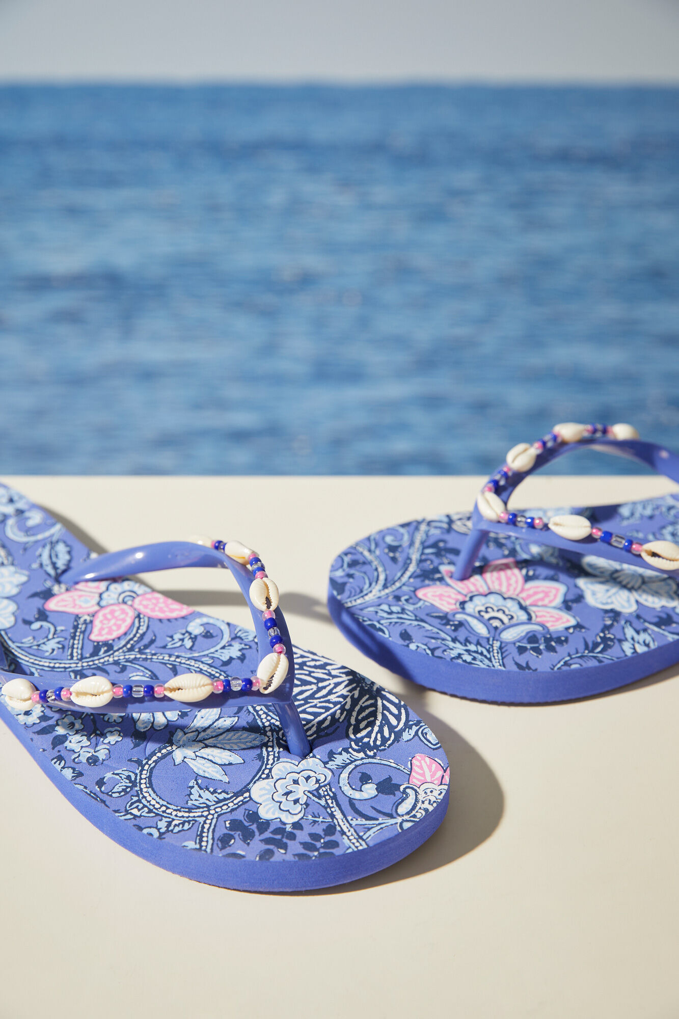 Flip flops printed with shells